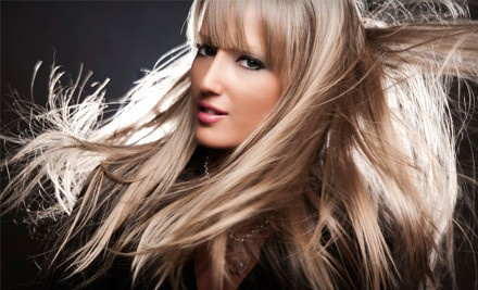 Haircut, Conditioning Treatment, and Style (a $41 value) - Studio North Salon in Williamsville