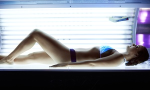One Spray Tan or Three UV Tanning Sessions at The Beach Club (Up to 59% Off)