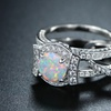 White Fire Opal interlocking Engagement Ring by Peermont
