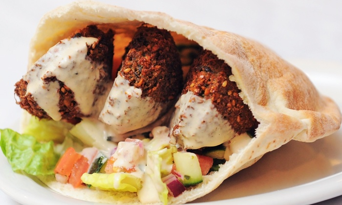King Falafel - Millburn: Middle Eastern Food for Dine-In, Carryout or Delivery at King Falafel (Up to 44% Off). Three Options Available.
