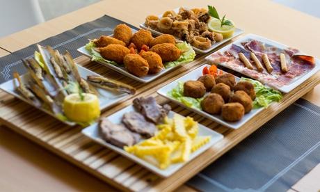 Menú para 2 o 4 con platos a compartir, postre o café y botella de vino o bebida desde 19,95 € en La Otra Esquina