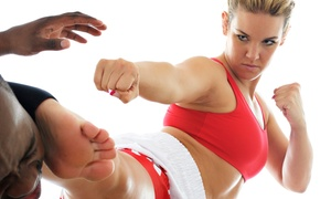 Trully Fit: Four or Eight Cardio Kickboxing, Zumba, or Boot-Camp Classes at Trully Fit (Up to 80% Off)