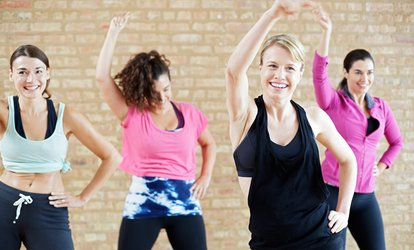 Four or Eight Zumba, Salsa or Hip Hop Classes at Tempo Dance Center (Up to 71% Off)