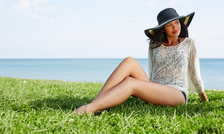 One or Three Spray Tans or a Five-Visit Tanning Package at Sun Tan City (Up to 78% Off)