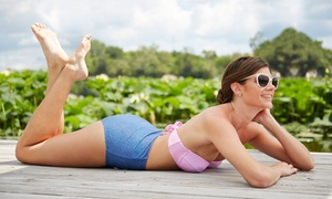 Sun Kiss'd Tanning: One Spray Tan or One Month of Tanning in a Level 1, 2, or 3 Bed at Sun Kiss'd Tanning ($44.99 Value)