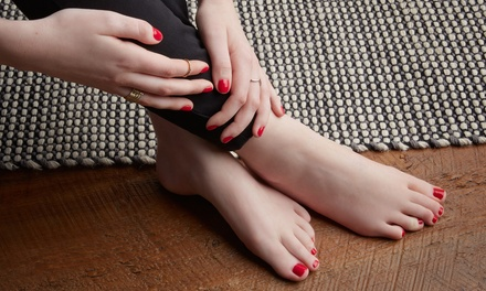 One or Three Groupons, Each Good for One Gel Mani and Regular Pedi at Village Four Nails and Spa (Up to 40% Off)