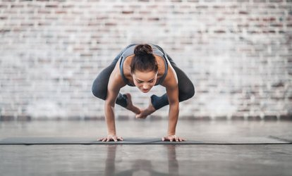 1 Month of Unlimited Hot Yoga or Pilates Classes for One ($29) or Two People ($55) at Hot Yoga by Belinda (Up to $320)