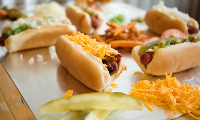 Mighty Dogs Cafe - Austin: Two Specialty Combos or One Hot Dog Combo a Week for Six Months or One Year at Mighty Dogs Cafe (Up to 55% Off)