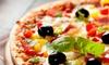 Green Pub - Rho: Menu pizza con bruschette, dolce e birra per 2 o 4 persone al Green Pub (sconto fino a 61%)