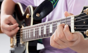 US Music Lessons: Four 30-Minute Private In-Studio or At-Home Voice or Instrument Lessons from US Music Lessons (Up to 54% Off)