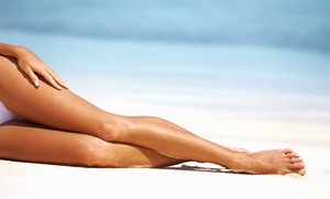 Tan Etc.: Month of Unlimited UV Tanning, One Custom Spray Tan, or Three Mystic Tan HD Tans at Tan Etc. (Up to 52% Off)