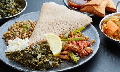 image for Two-Course East African Dinner for Two or Four at Shamrock Restaurant (47% Off)
