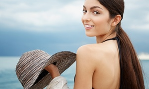 Hollywood Tans: One-Month All-Inclusive Membership, 4 Custom Airbrush Tans, or 4 Detox Wraps at Hollywood Tans (Up to 76% Off)