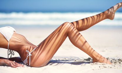 One Month of UV Stand-Up <strong>Tanning</strong> or Three Mystic Spray Tan Sessions at American Made Tans (Up to 53% Off)