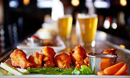 Up to Six House Beverages or Chicken Wings with Malt Beverages at Harvesters Pub - Holiday Inn Downtown (Up to 50% Off)