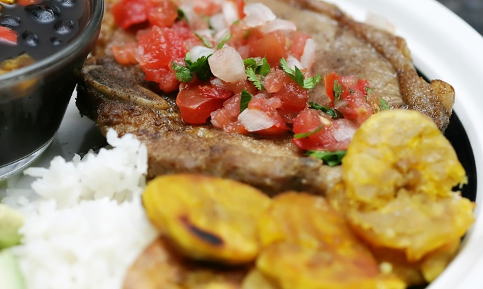 La Bomba - North Side: $12 for Two Groupons, Each Good for $10 Worth of Puerto Rican Cuisine ($20 Total Value)