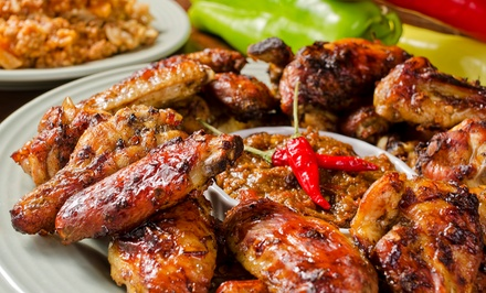 Caribbean Cuisine at Caribbean Circle Grill N' Tingz (Up to 50% Off). Four Options Available.