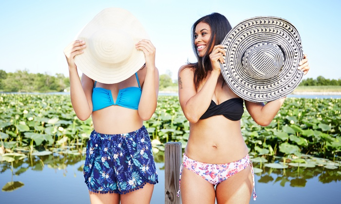 Miami Tan - Multiple Locations: One Full-Body Airbrush Tan or One Month of Unlimited UV Tanning in Level-One Bed at Miami Tan (Up to 59% Off)
