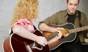 Amped Music School: Two or Four 30-Minute In-Home Guitar Lessons from Amped Music School (Up to 62% Off)