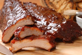 The Sauced Pig: Barbecue, Sides, and Drinks for Two or Four at The Sauced Pig (Up to 50% Off)