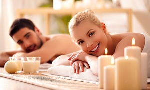 Massage Xcape: $129 for Fireside Couples Massage with Complimentary Beverage at Massage Xcape ($259 Value)