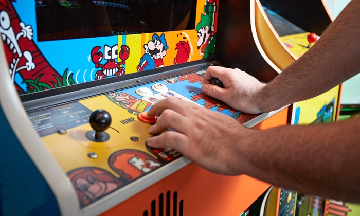 Level Up Kitchen and Barcadium - Central Raleigh: Pub Food and Arcade Tokens at Level Up Kitchen and Barcadium (Up to 44% Off). Two Options Available.