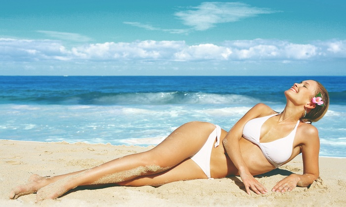 Electric Beach Tanning - Multiple Locations: One or Three Spray Tans or One Month of UV Tanning at           Electric Beach Tanning          (Up to 56% Off)