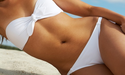 Airbrush Tan or One Month of Unlimited Regular or Super Bed Tanning at Island Tan Topeka (Up to 53% Off)