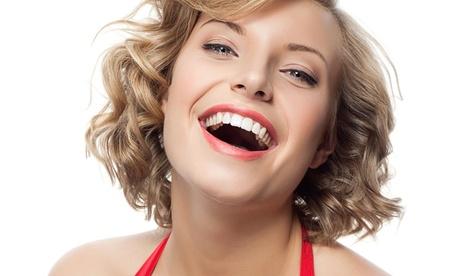 1 o 2 implantes dentales de titanio con corona de metal-porcelana y limpieza bucal desde 499 €