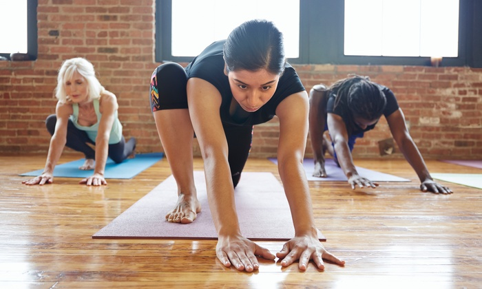 Power Play Flow Yoga - PowerPlay Fitness Center: $29 for One Month of Unlimited Hot Yoga Classes at Power Play Flow Yoga ($130 Value)