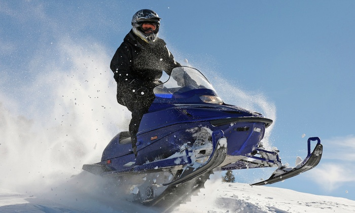 New England Outdoor Center - Millinocket: $89 for a Four-Hour Snowmobile Rental for One or Two at New England Outdoor Center ($155 Value)
