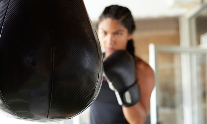 Impact Fitness - Multiple Locations: 10 or 20 Kickboxing Classes with Boxing Gloves at Impact Fitness (Up to 85% Off). Four Options Available.