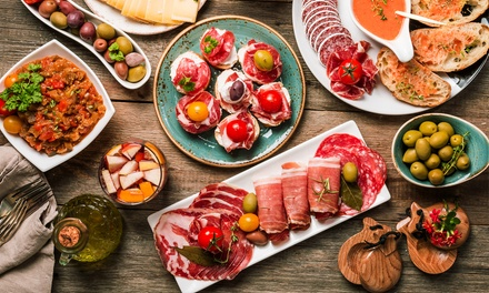 Six or 12 Tapas, or One or Two Paellas with Wine for Two or Four at Pinchos