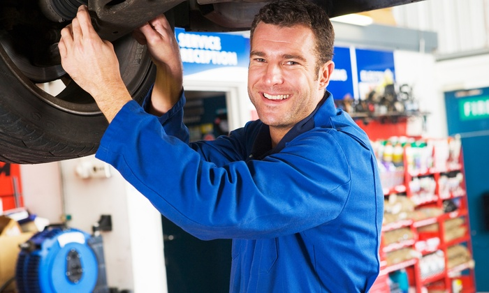 Oil-Change Package or Automotive Services at Midas Auto Service & Tire (Up to 51% Off). Three Options Available.