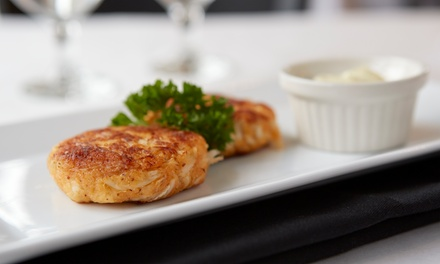 One or Three Groupons, Each Good for $30 Worth of New American-Style Food at Crème de la Crème (Up to 47% Off)