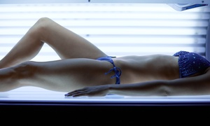 Tanning Studios: One Month of Unlimited Level 1 Bed Tanning or Three Spray Tans at Tanning Studios (Up to 47% Off)