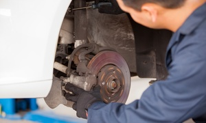 Brake Center: Oil Change Package or Brake Installation for Two or Four Disc Pads at Brake Center (Up to 52% Off)