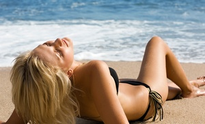 California Tanning Club: Week of Unlimited Tanning in a Bed or Spray Tan with Top-Level Artist at California Tanning Club (Up to 82% Off)