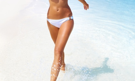 One Spray Tan or Three UV Tanning Sessions at The Beach Club (Up to 51% Off)