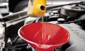 H.T. Auto Service: Conventional, Synthetic, or High-Mile Oil Change with Tire Rotation at H.T. Auto Service (Up to 44% Off)