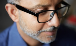 Cohen's Fashion Optical: Eye Exam with $385 Credit Towards Complete Designer Frames with Lenses (92% Off)