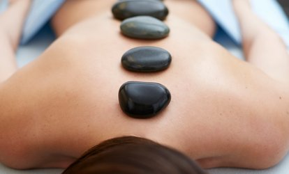 image for $59 for 60-Minute Hot Stone <strong>Massage</strong> with <strong>Foot</strong> Sugar Scrub at Luxury Salon and Spa ($115 Value)