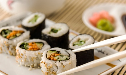 Sushi Dinner for Two or Four with Appetizers, Sushi Rolls, and Dessert at Umi Sushi Bar & Grill (Up to 46% Off)