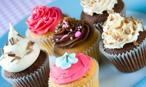 Sweet Eats Bake Shop: One or Two Dozen Cupcakes or One Small Frosted Cake at Sweet Eats Bake Shop (Up to 48% Off)
