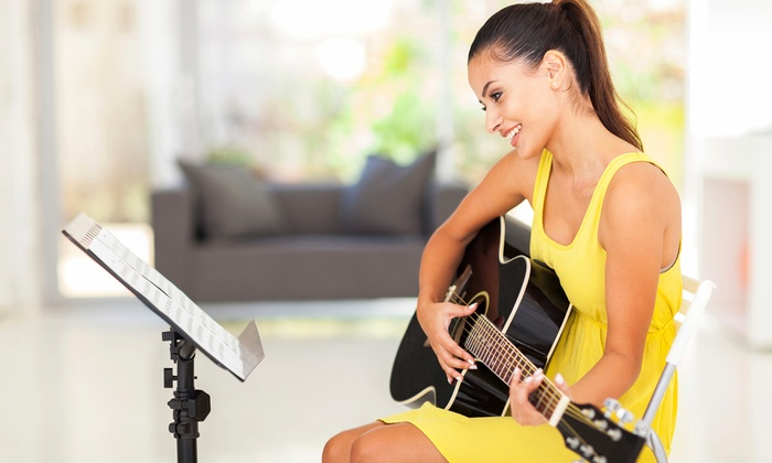 Guitar New York - Midtown Center: Two or Four Guitar, Bass, or Ukulele Lessons, or Five Choose Your Song Lessons at Guitar New York(Up to 52% Off)