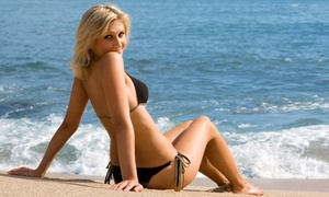 TNT Tanning: Four Spray Tans or a  Month of Unlimited Level 2 or 3 Tanning at TNT Tanning (Up to 65% Off)