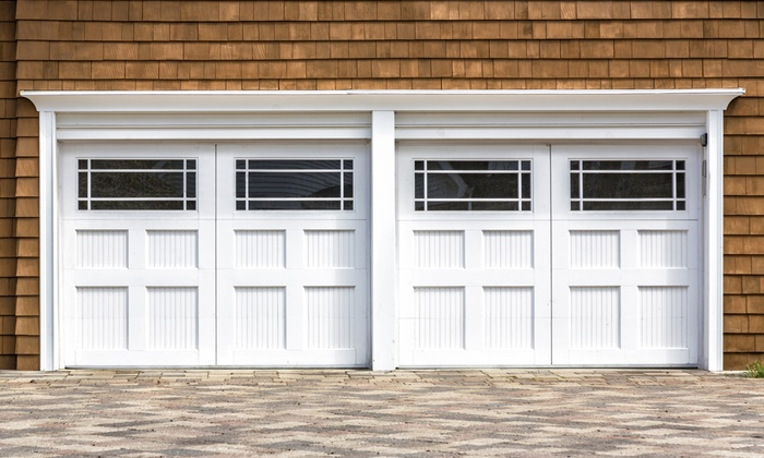 Garage Door Service Co. - Dallas: Garage-Door Tune-Up and Inspection with Optional Roller Replacement from Garage Door Service Co. (Up to 77% Off)