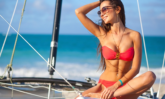 Sun City Tanning Salon - Multiple Locations: Two or Three VersaSpa Spray Tans or One Month of Unlimited UV Tanning at Sun City Tanning Salon (Up to 64% Off)