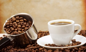 Fé Coffee House: $15 for Five Groupons, Each Good for $5 Worth of Coffee or Tea ($25 Value)