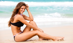 Studio Sun & Beauty: Stand-Up Tanning Booth Service or Three or Five Custom Norvell Spray Tans at Studio Sun & Beauty (Up to 68% Off)